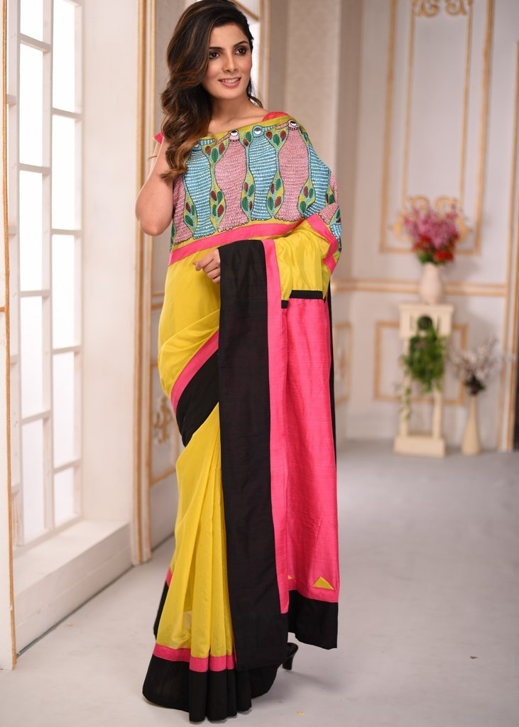 Yellow chanderi saree with hand painted tribal gond art in front - Sujatra