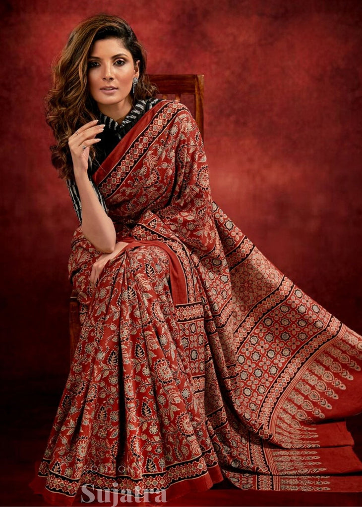 Ajrakh block printed saree with ikat blouse combination