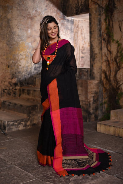 Pure black linen saree with a kalamkari patch on pallu