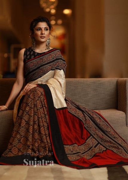 Combination of block printed cotton Ajrakh pleats & pure tassar silk saree with Ajrakh border