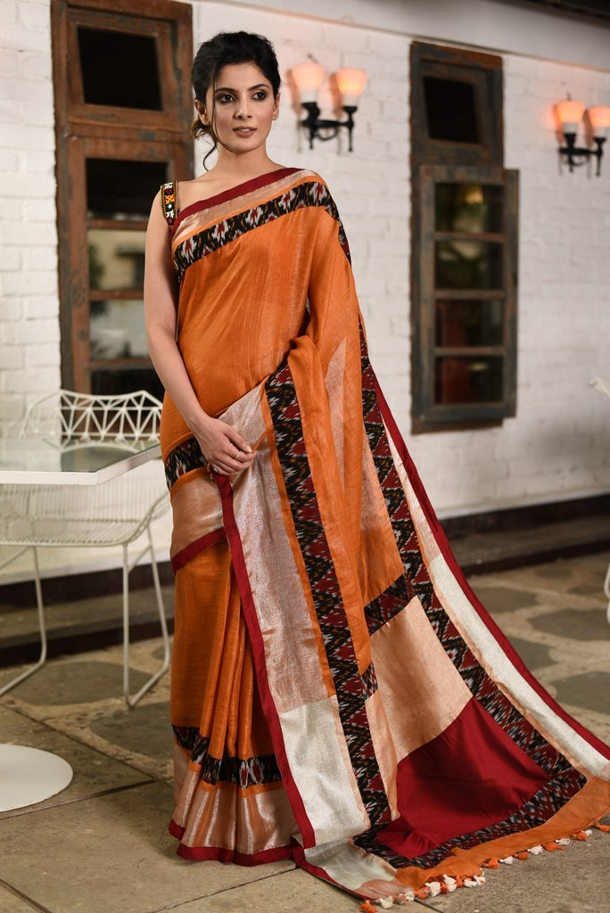Exclusive rust colored pure linen saree with ikat & zari border - Sujatra