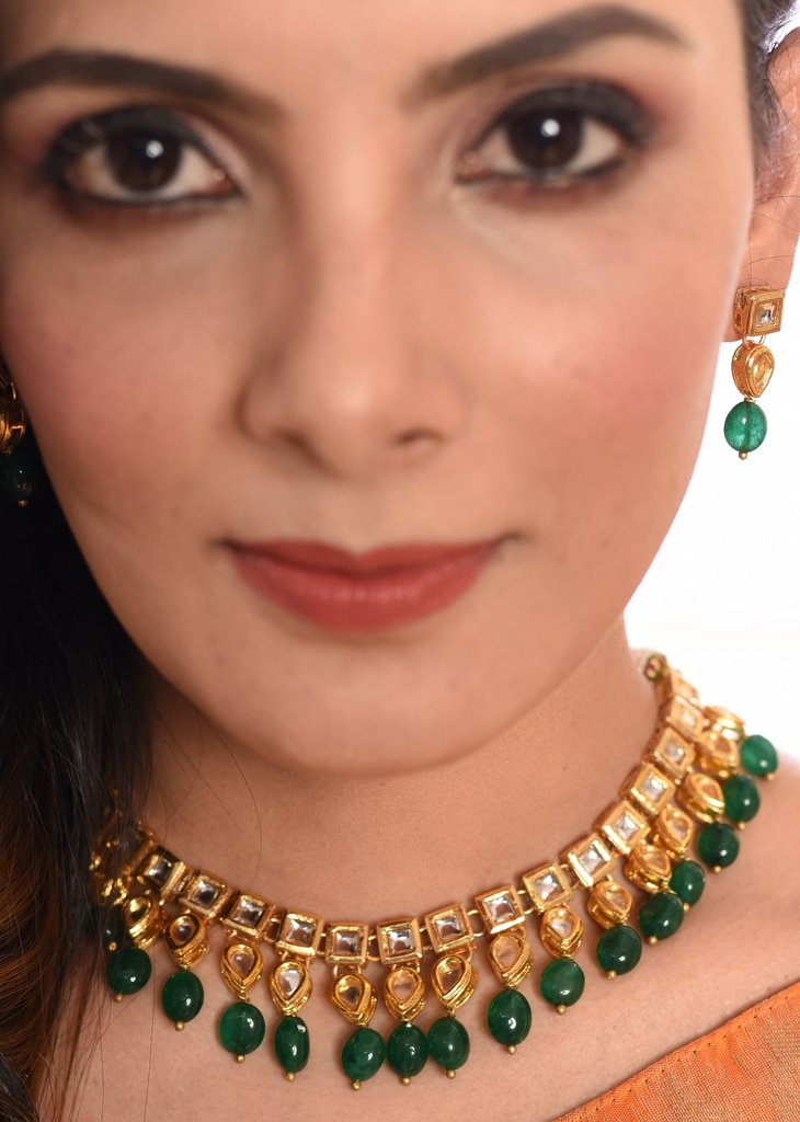 Exquisite kundan neklace set with green stone