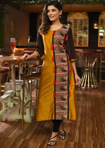 Mustard cotton silk kurti with kalamkari patch in front with red tassels