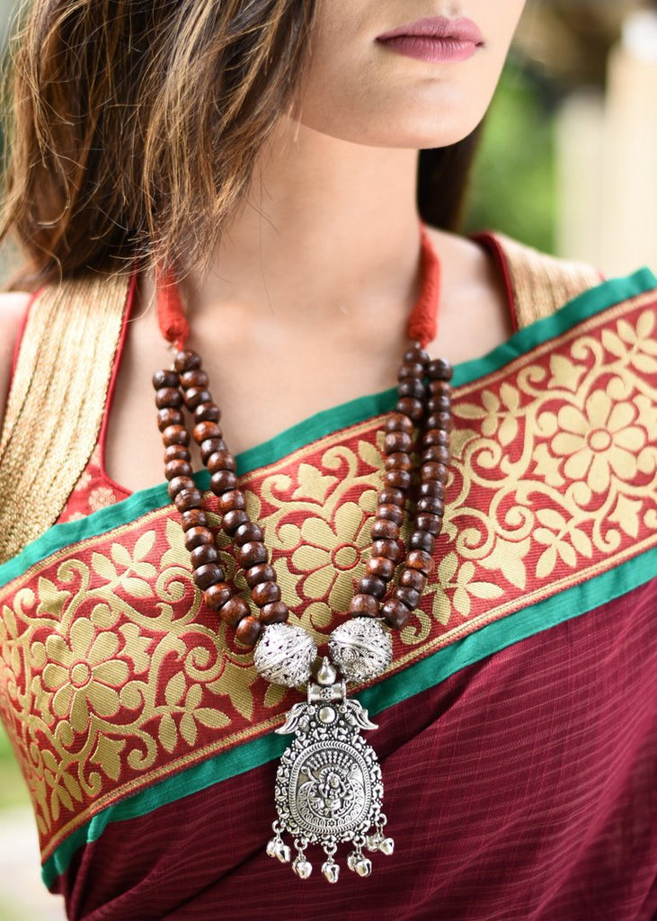 Exclusive double layered wooden beaded ethnic necklace with german silver pendant - Sujatra