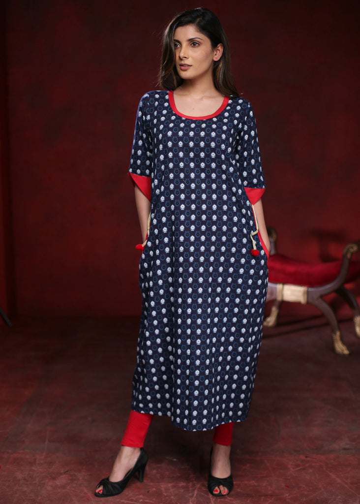 Blue loose fit cotton kurta with flower motifs and curved side pockets - Sujatra