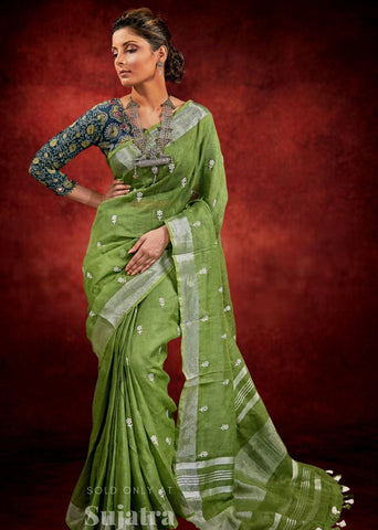 Green pure linen embroidered saree with zari border