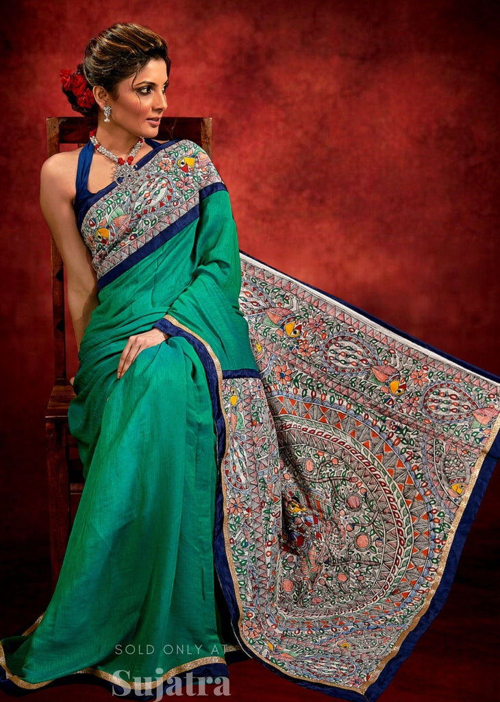 Green satin saree with exclsuive Madhubani painting