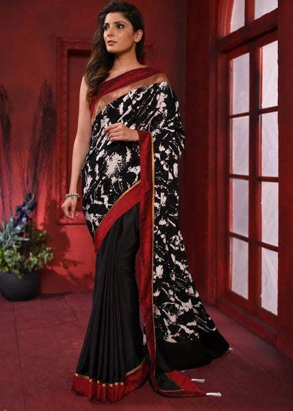 Exclusive printed & black crepe satin saree with zari border