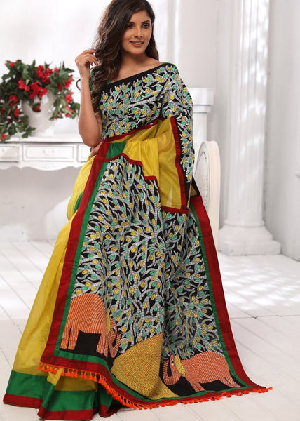Yellow chanderi saree with hand painted gond tribal art pallu & front