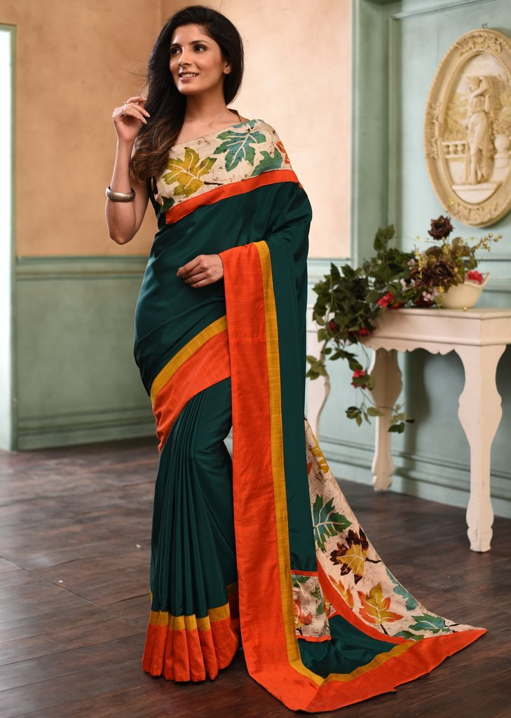 Forest green french crepe saree with hand batik work