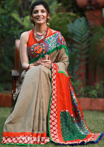 Beige handloom cotton saree with hand painted mahubani border & sambalpuri ikat patch on pallu