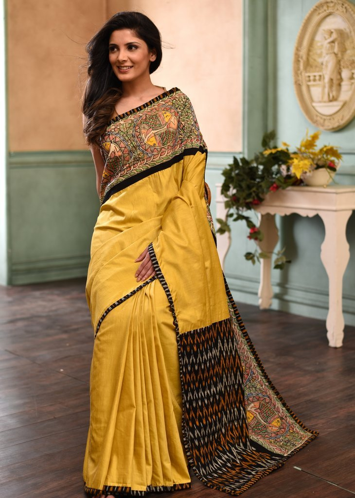 Mustard semi silk saree with intricate hand painted madhubani border & ikat pallu