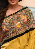Mustard semi silk saree with intricate hand painted madhubani border & ikat pallu - Sujatra