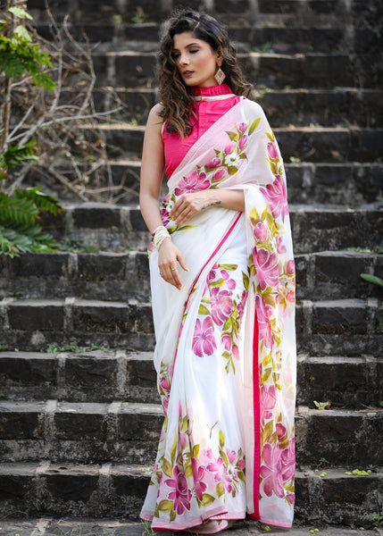 Exclusive hand painted chiffon saree with floral motifs