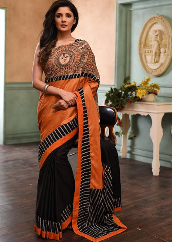 Exclusive orange semi silk saree with hand painted madhubani work & ikat border
