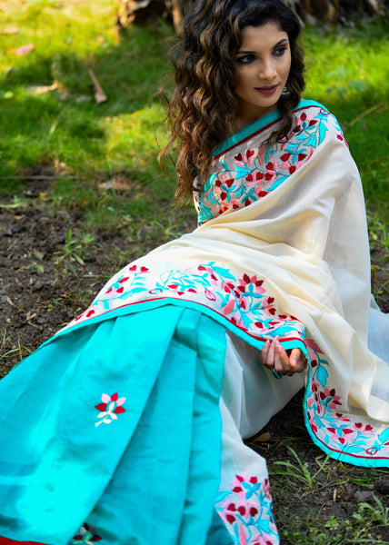 Exclusive sea green and beige chanderi combination saree with floral embroidered motifs all over
