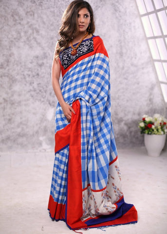 Gamcha cotton saree with hand batik work on border & ikat patch on pallu