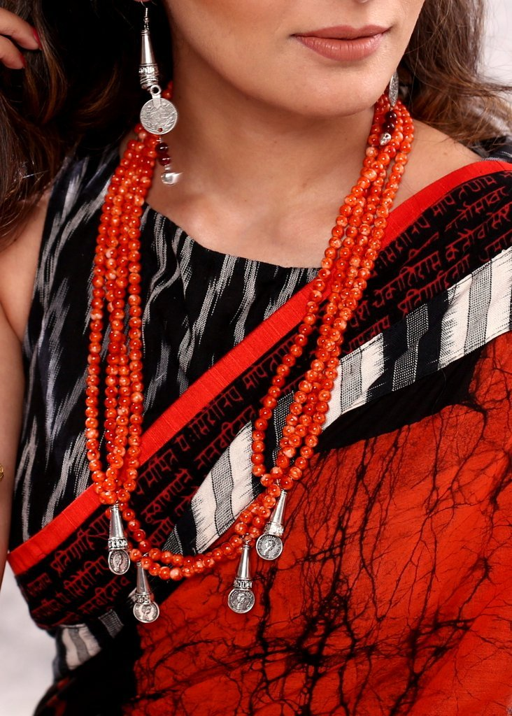 Handmade orange beaded layered necklace set with oxidised coin tassels