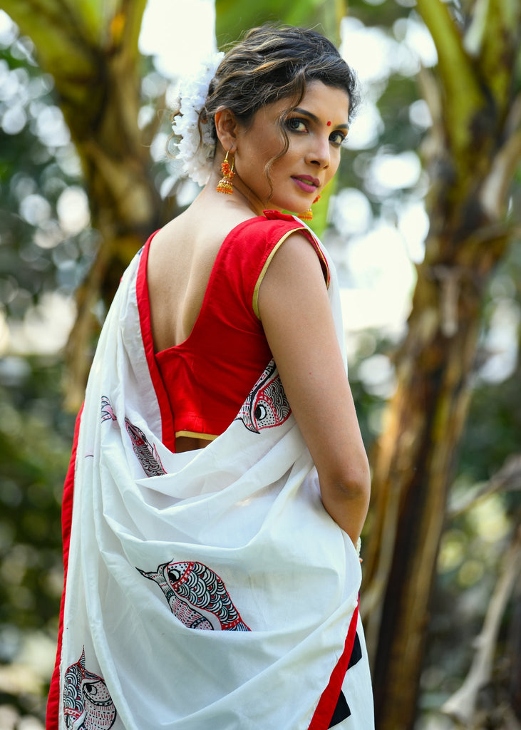 Exclusive white chanderi saree with hand painted gond tribal art