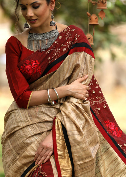 Exclusive Raw silk saree with embroidered cotton pleats & border