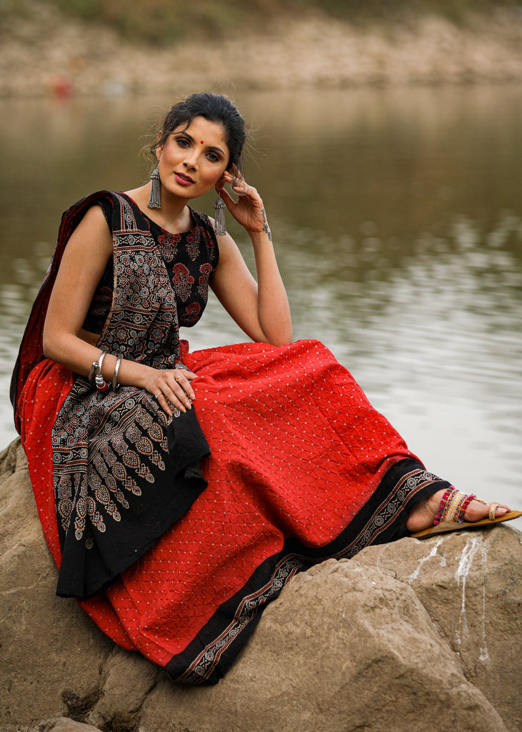 Exclusive bandhej saree with Ajrakh block printed border & pallu