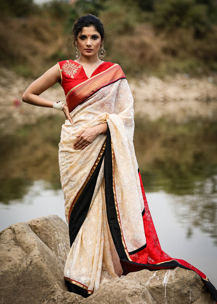 Exclusive embroidered georgette saree with red net pallu & zari border