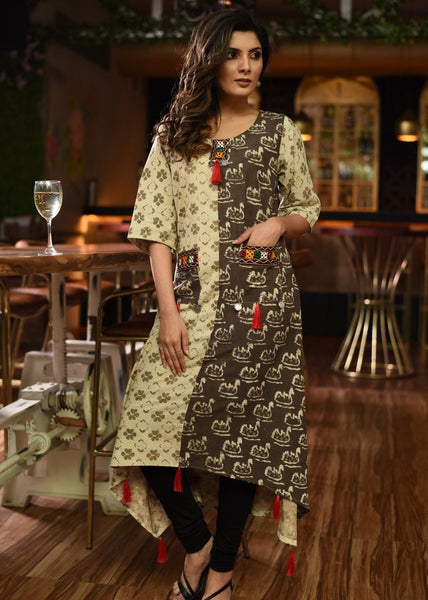 Printed cotton kurti with kutch mirror work on pockets & red tassels