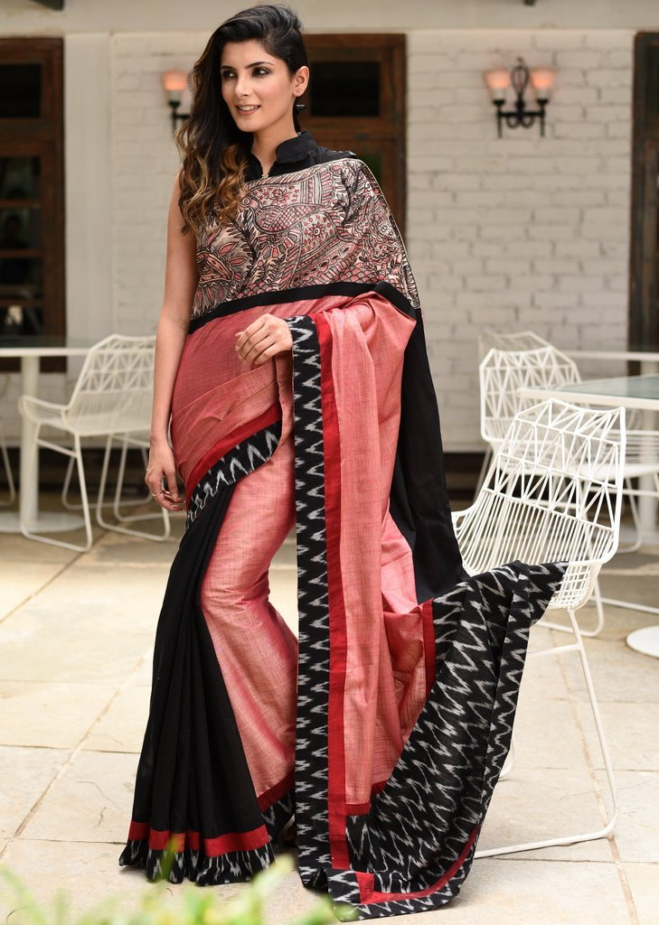 Intricate hand painted madhubani work with pale pink semi silk saree & ikat border