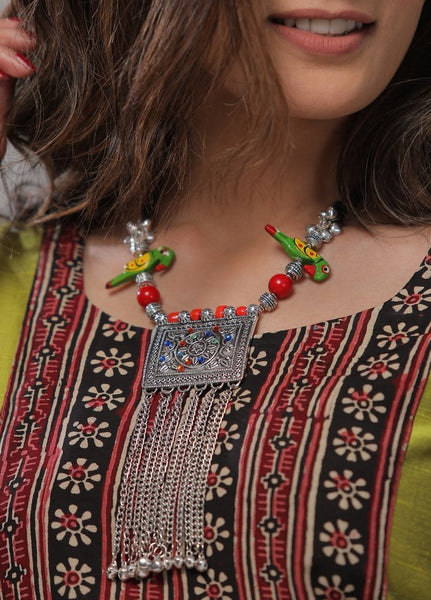 Handmade neckpiece  with a combination of wooden parrots, beads, ghungroo with oxidised pendant