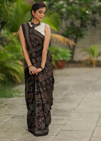 Pure modal silk ajrakh block printed black designer saree with floral motifs