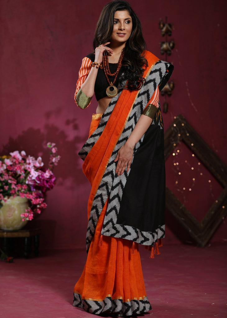 Orange Pure linen saree with ikat borders - Sujatra