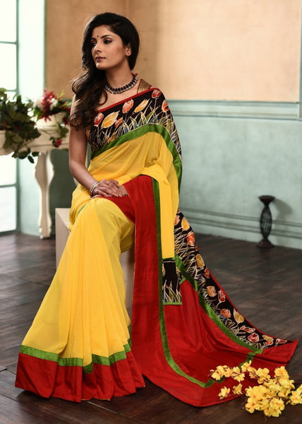 Yellow georgette viscose saree with hand batik work