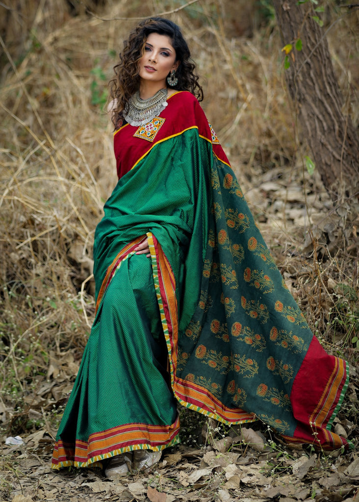Exclusive green khun saree with block printed Ajrakh pallu and kutchi mirror work patches