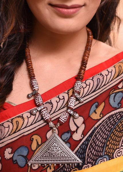 Wooded beaded necklace set with german silver pendant - Sujatra