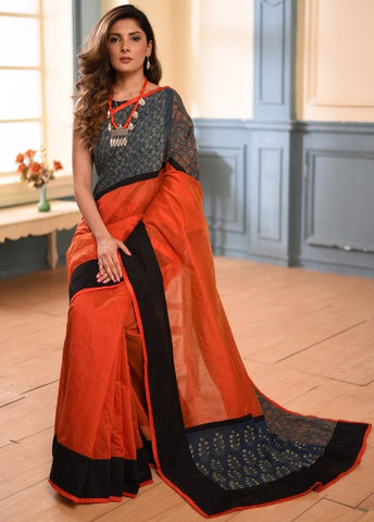 Dark orange chanderi saree with hand block printed ajrakh border