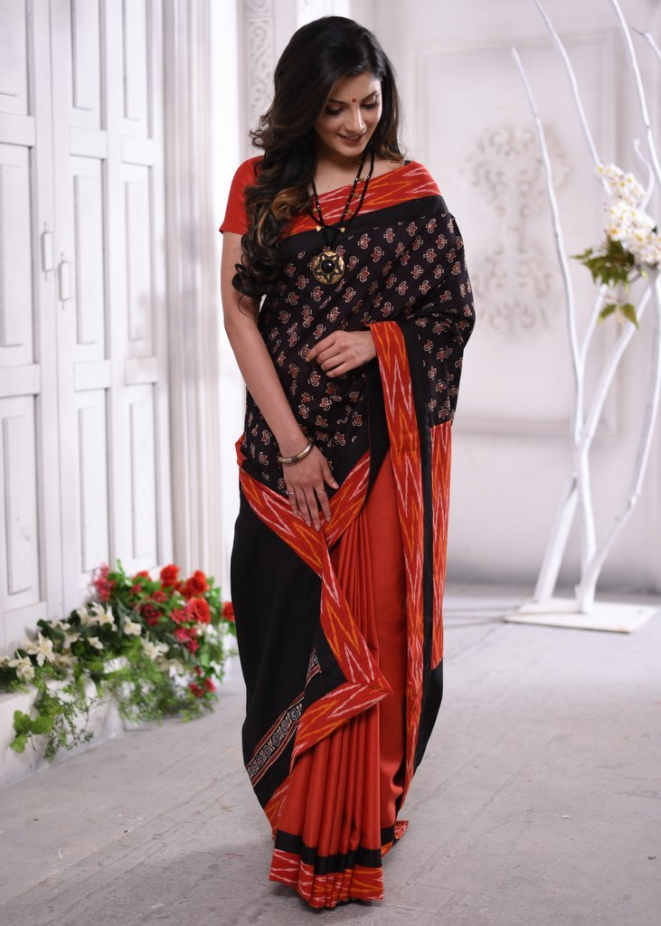 Combination of Ajrakh block print on pure tussar silk with red cotton pleats & ikat pallu & border saree - Sujatra