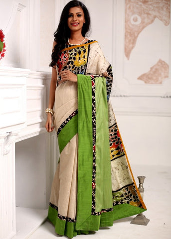 Beige chanderi saree with hand batik border and green silk pallu