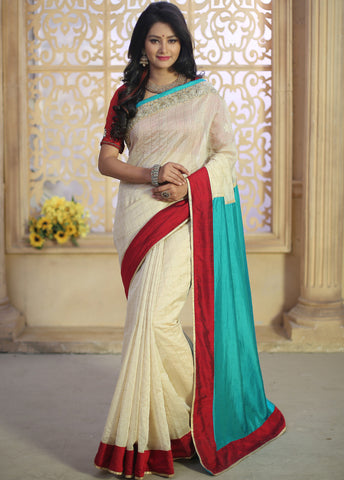 Beige chanderi with golden checks combined with green barfi silk & zari work border