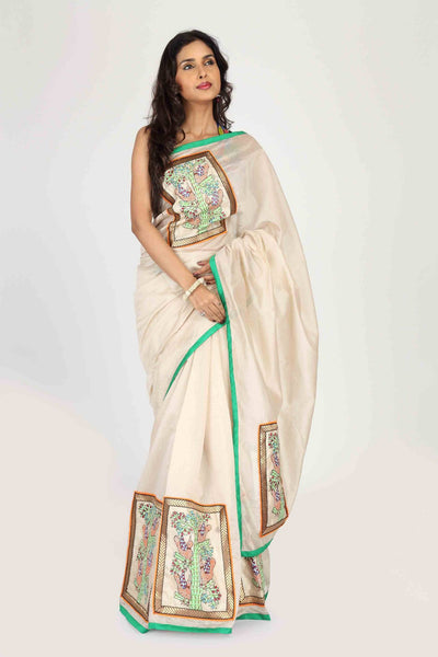 Beige Chanderi with Hand painted Gond Tribal art on front, pleats & Pallu with green piping - Sujatra