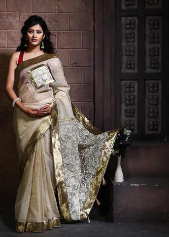 Beige kota with embroidered pallu and patch on front & zari border