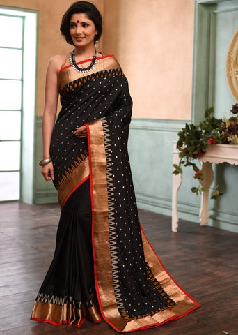 Black tafeta saree with buta all over with ikat border & french crepe pleats