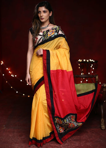 Combination of yellow & red chanderi saree with hand batik work in front & pallu