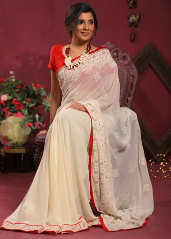 Exclusive Embroidered off white georgette saree with zari border