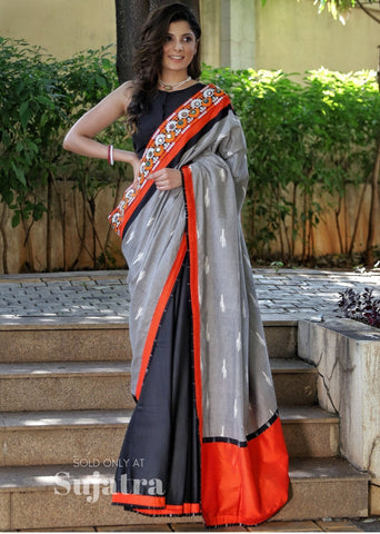 Exclusive grey ikat saree with embroidered border & black handloom cotton pleats