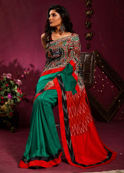Saree - Green Crepe Satin Saree With Hand Painted Madhubani Work And Ikat Pallu