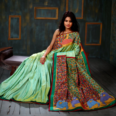 Hand painted Gond art pallu and front with pure raw silk base saree