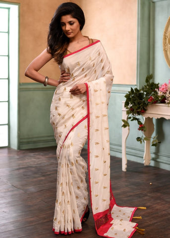 Off White embroidered faux soft silk saree with pink piping