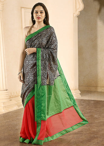Peach semi georgette with parrot green chanderi and black zari on pallu