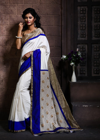 Pure White Chanderi with pearl embroidered pallu & zari border