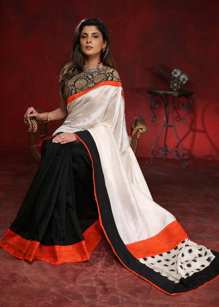 White pure silk with black semi silk saree with exclusive zari border with ikat patch on pallu - Sujatra